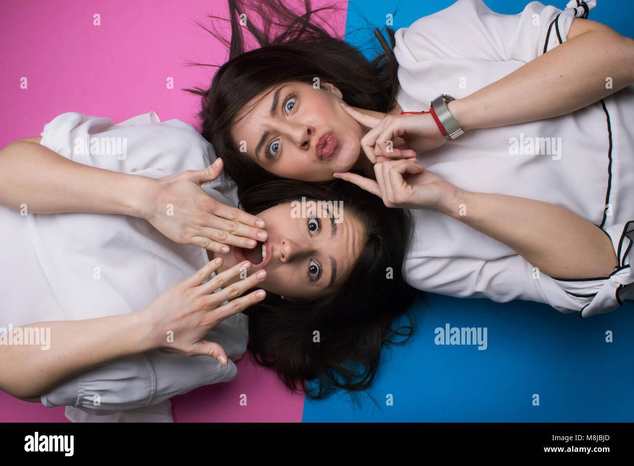 girls making faces - Stock Image