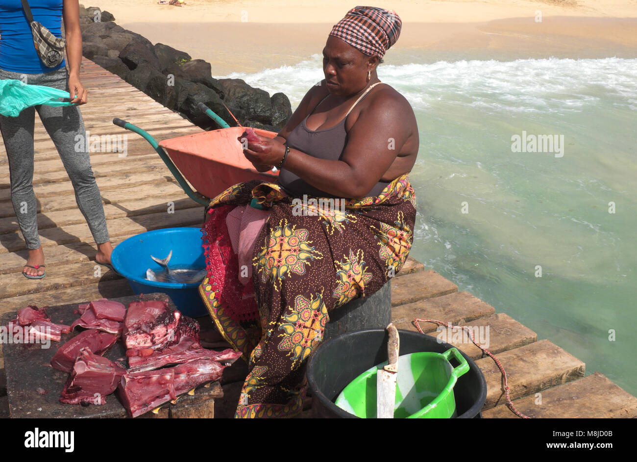 Female fish seller on main pier at Santa Maria, Sal Island, Cape Verde. Cape Verde comprises several islands in - Stock Image