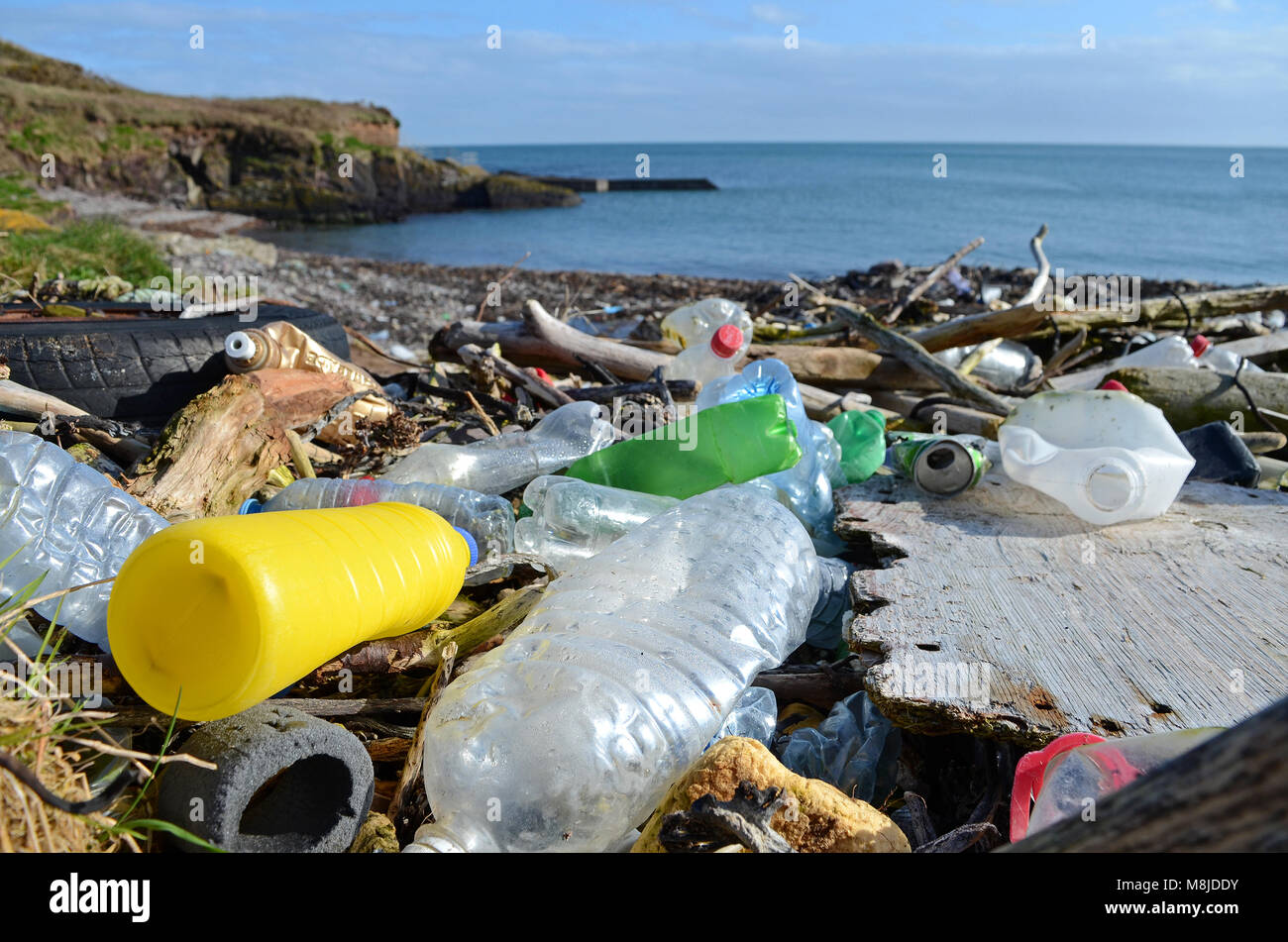 discarded plastic waste washed up on the beach at trabolgan on the southwest coast of ireland. - Stock Image