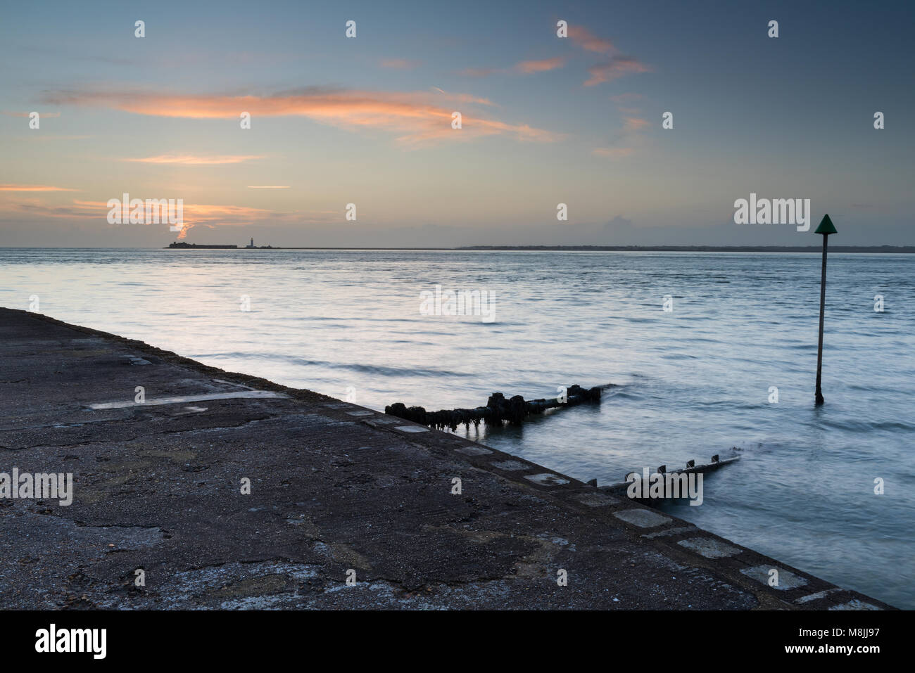 a beautiful and atmospheric seascape or landscape on the coast of the isle of wight with hurst castle and keyhaven - Stock Image