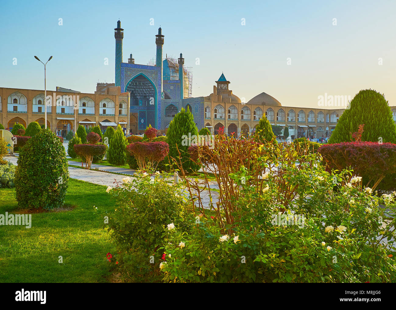 The beautiful garden of Naqsh-e Jahan square with trimmed bushes, blooming plants and juicy lawn is the best place Stock Photo