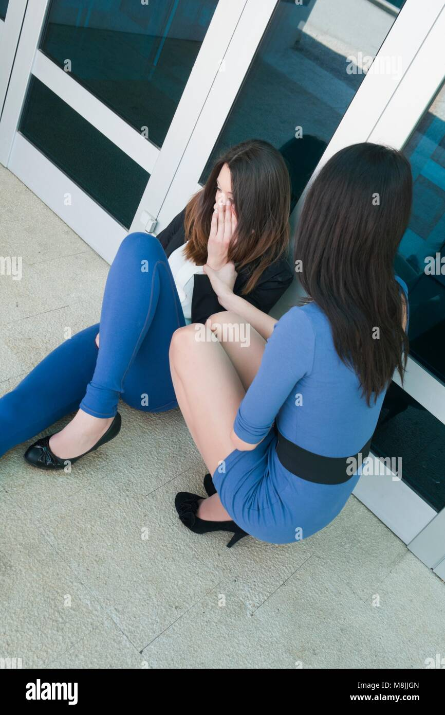 Beautiful teenager girls friends compassion - Stock Image
