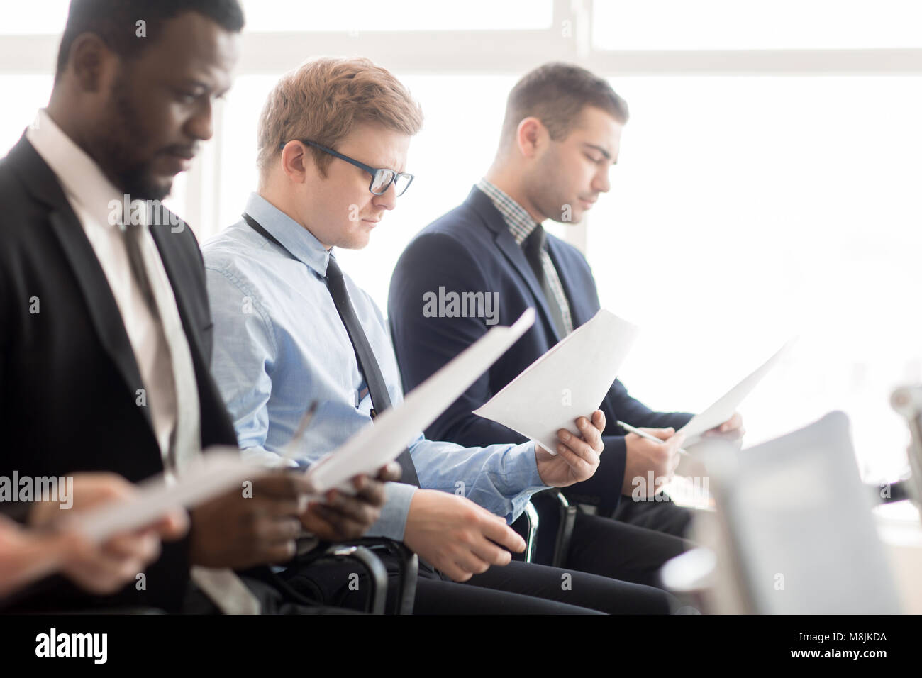 Reading further information - Stock Image