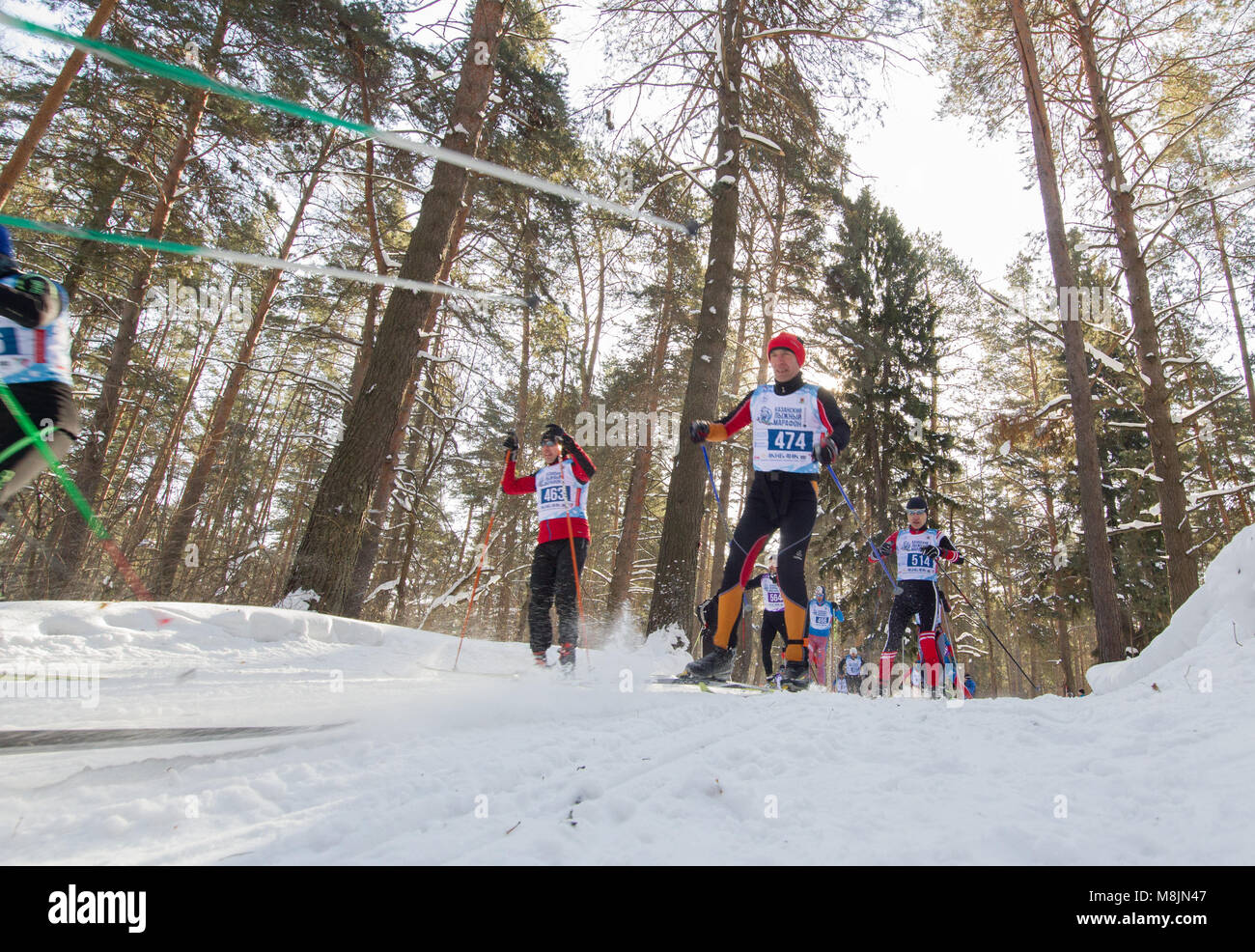 KAZAN, RUSSIA - March, 2018: professional winter ski race with many athletes running one after the other, wide angle - Stock Image
