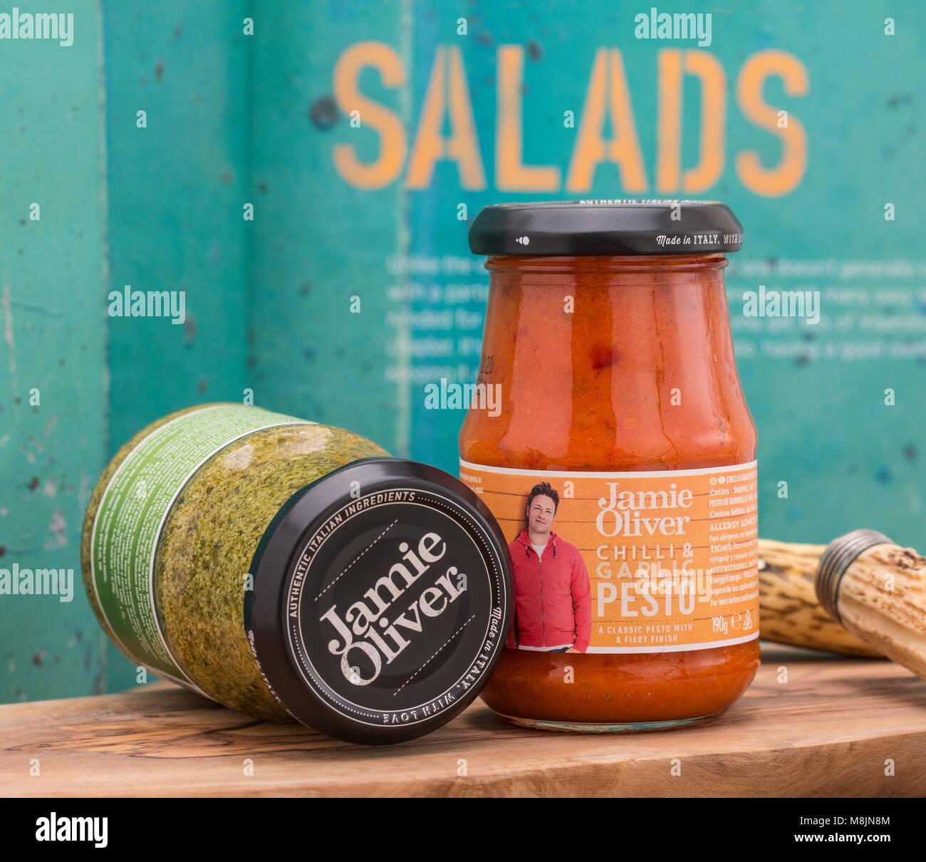 SWINDON, UK - MARCH 18, 2018: Two Jars of Jamie Oliver Pesto, Authentic Italian Ingredients - Stock Image