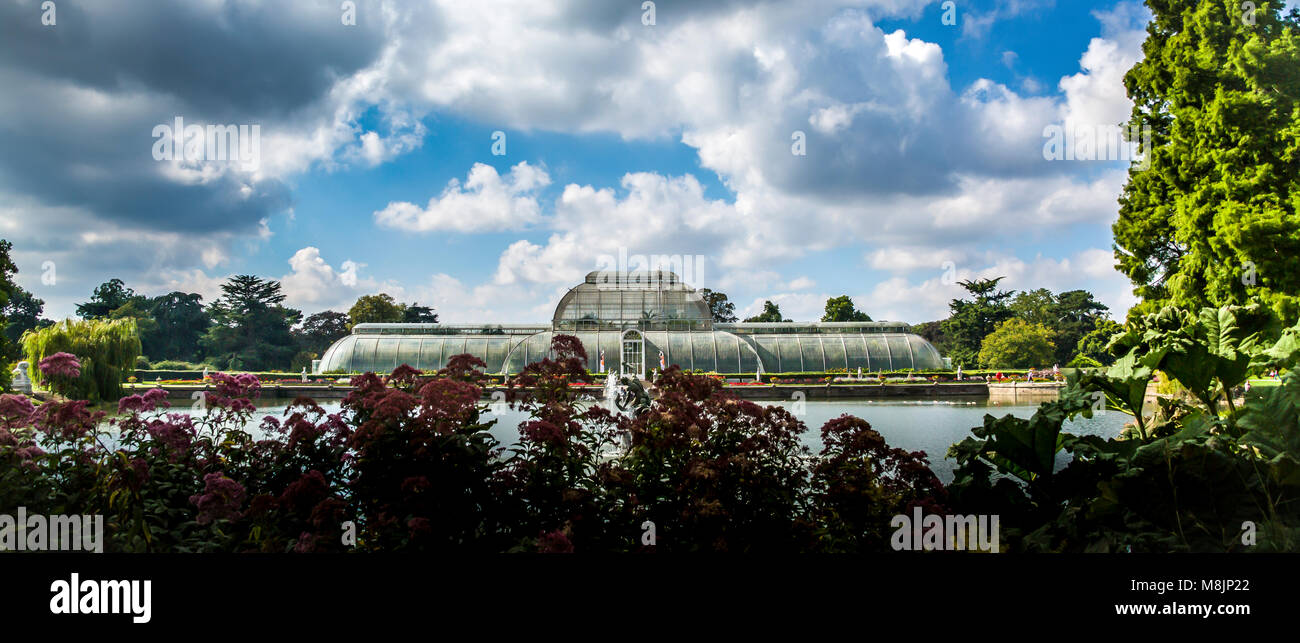 The Victorian Palm House sits surrounded by nurtured trees and plants in the magnificent Royal Botanical Gardens - Stock Image