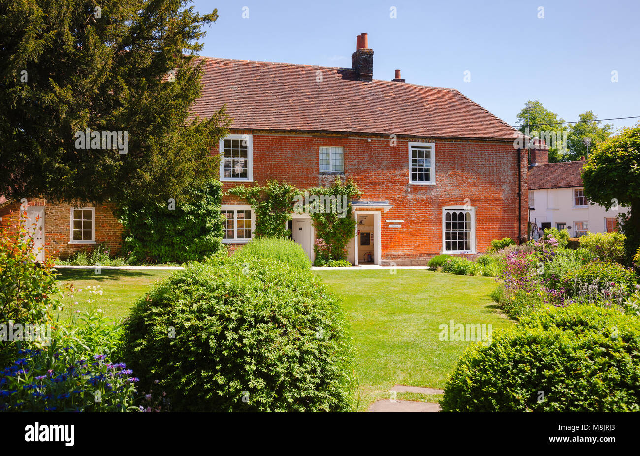 CHAWTON, UK - JUN 8, 2013: Green lawn at formal garden of Chawton Cottage, an independent museum of novelist Jane - Stock Image