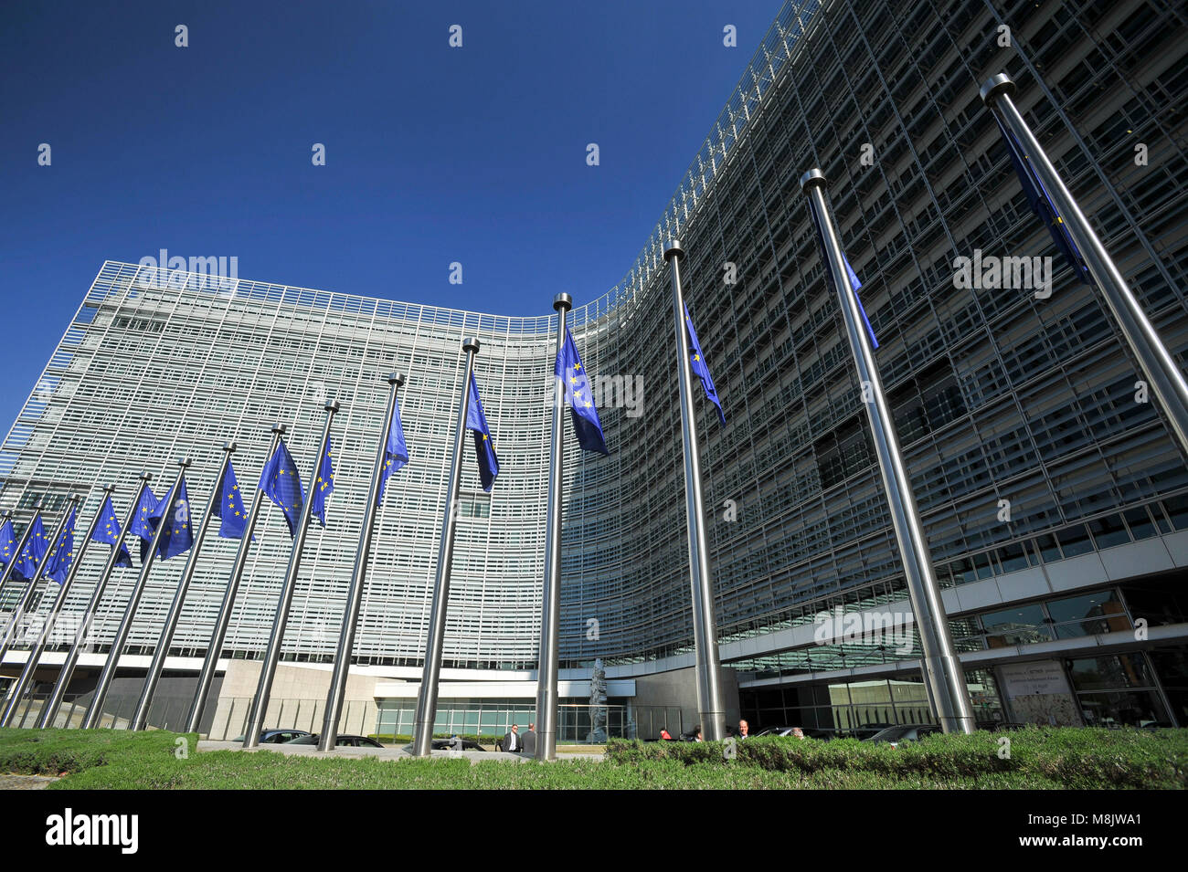 EU flags in front of Berlaymont building, headquarters of the European Commission, on Rue de la Loi / Wetstraat - Stock Image