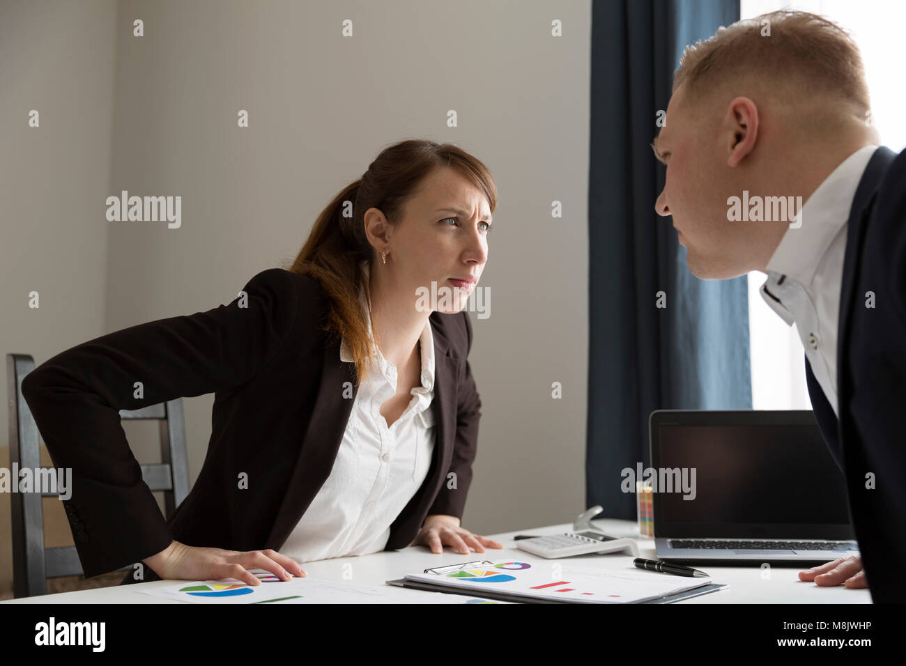 Office conflict between man and woman. Competition between men and women. Feminism concept - Stock Image