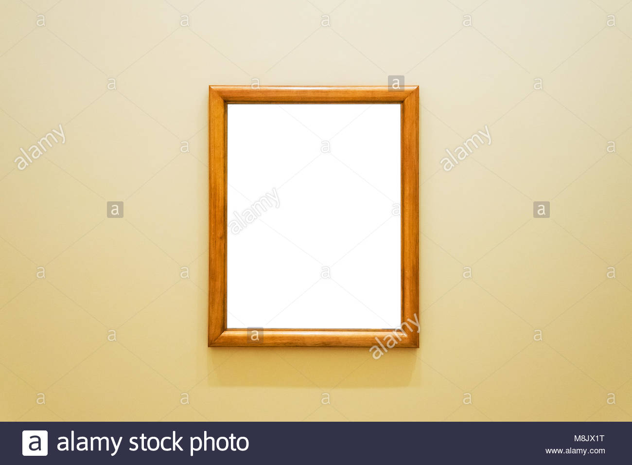 White clipped painting with wooden frame hung on a wall Stock Photo ...