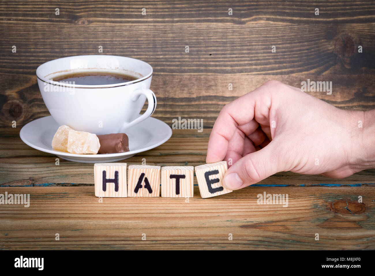 Hate. Wooden letters on the office desk, informative and communication background - Stock Image