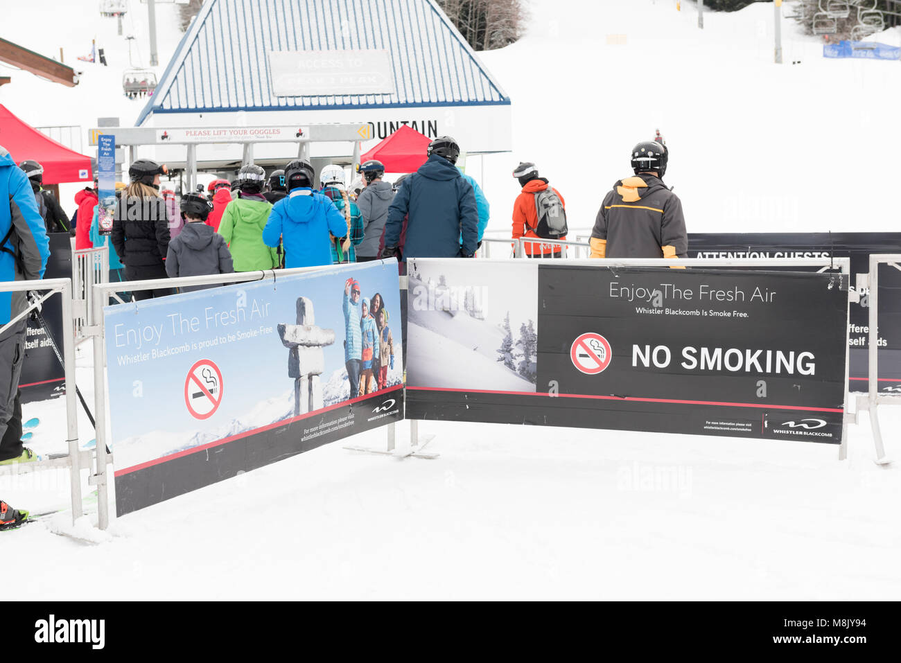 People in line for the chairlift at Whistler Blackcomb ski resort. Stock Photo
