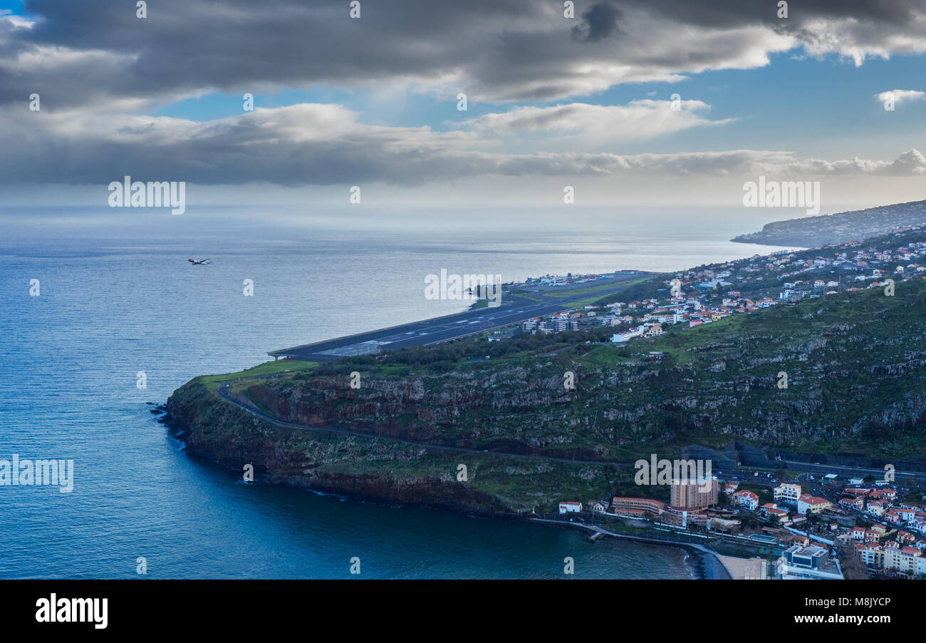 View on Funchal airport with starting plane - Stock Image