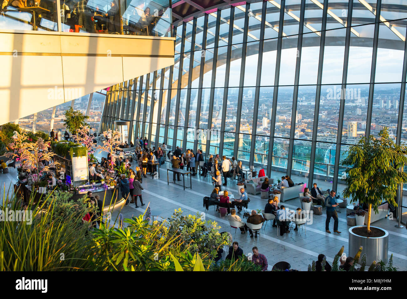 People enjoying the spectacular Sky Garden situated on the top floor of 20 Fenchurch Street skyscraper, offers a - Stock Image