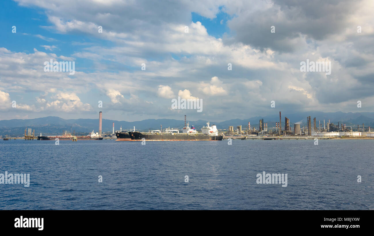 View of big ships in industrial zone in Milazzo on Sicily, Italy Stock Photo