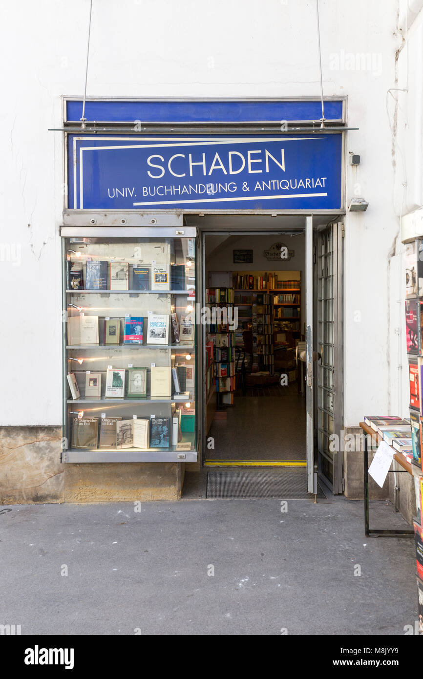 Entrance to bookstore in Austria, open door and display window books. Stock Photo