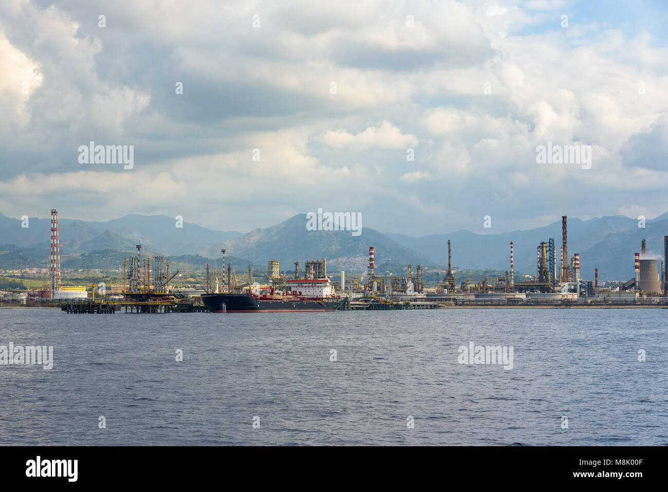 Industrial zone in Milazzo town on Sicily seen from the sea, Italy Stock Photo