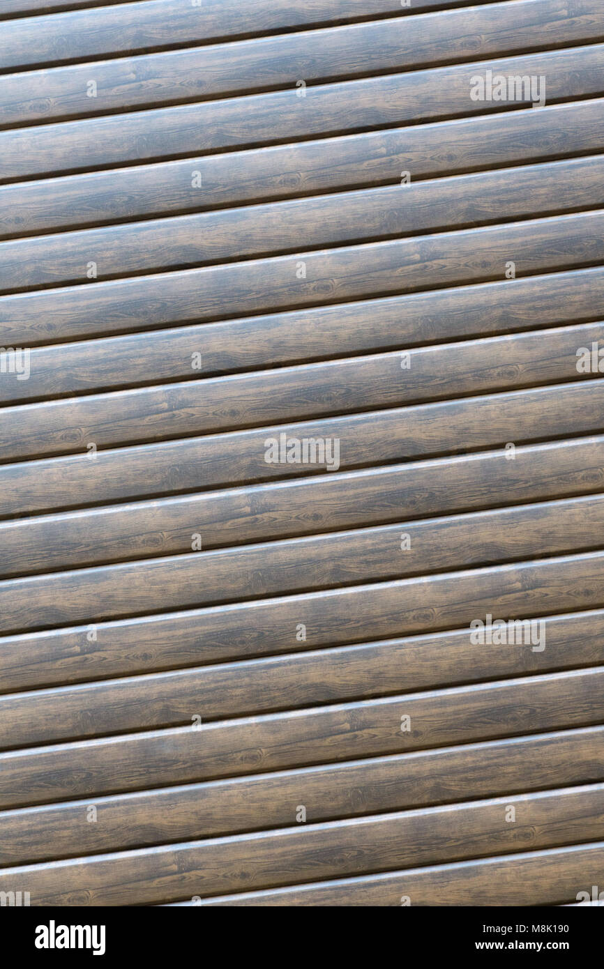 Vintage brown barrel wooden planks background texture with scratches and black stains over wood grain of old aged - Stock Image