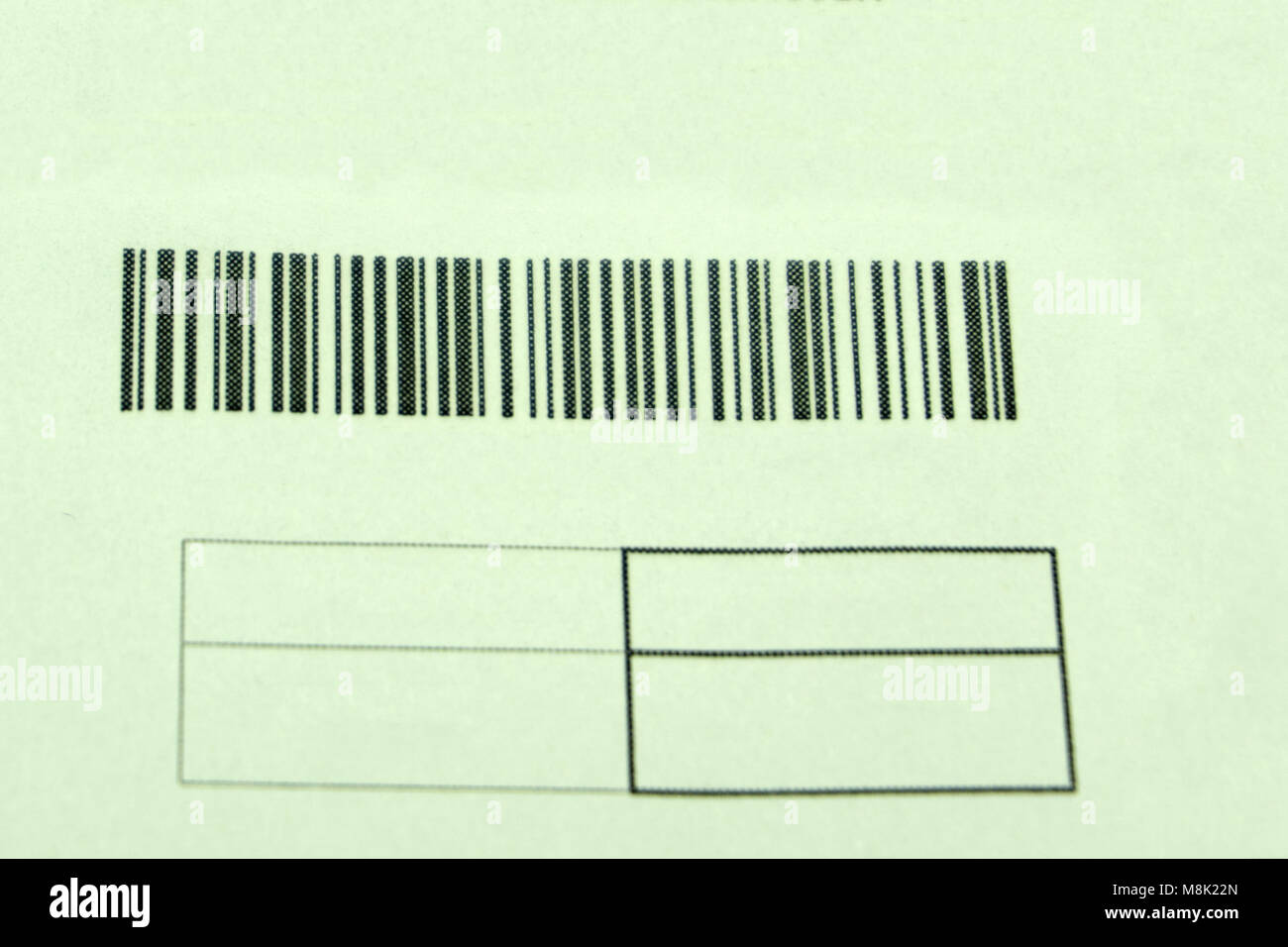 Barcode label on shipping box being scanned with red laser device - Stock Image