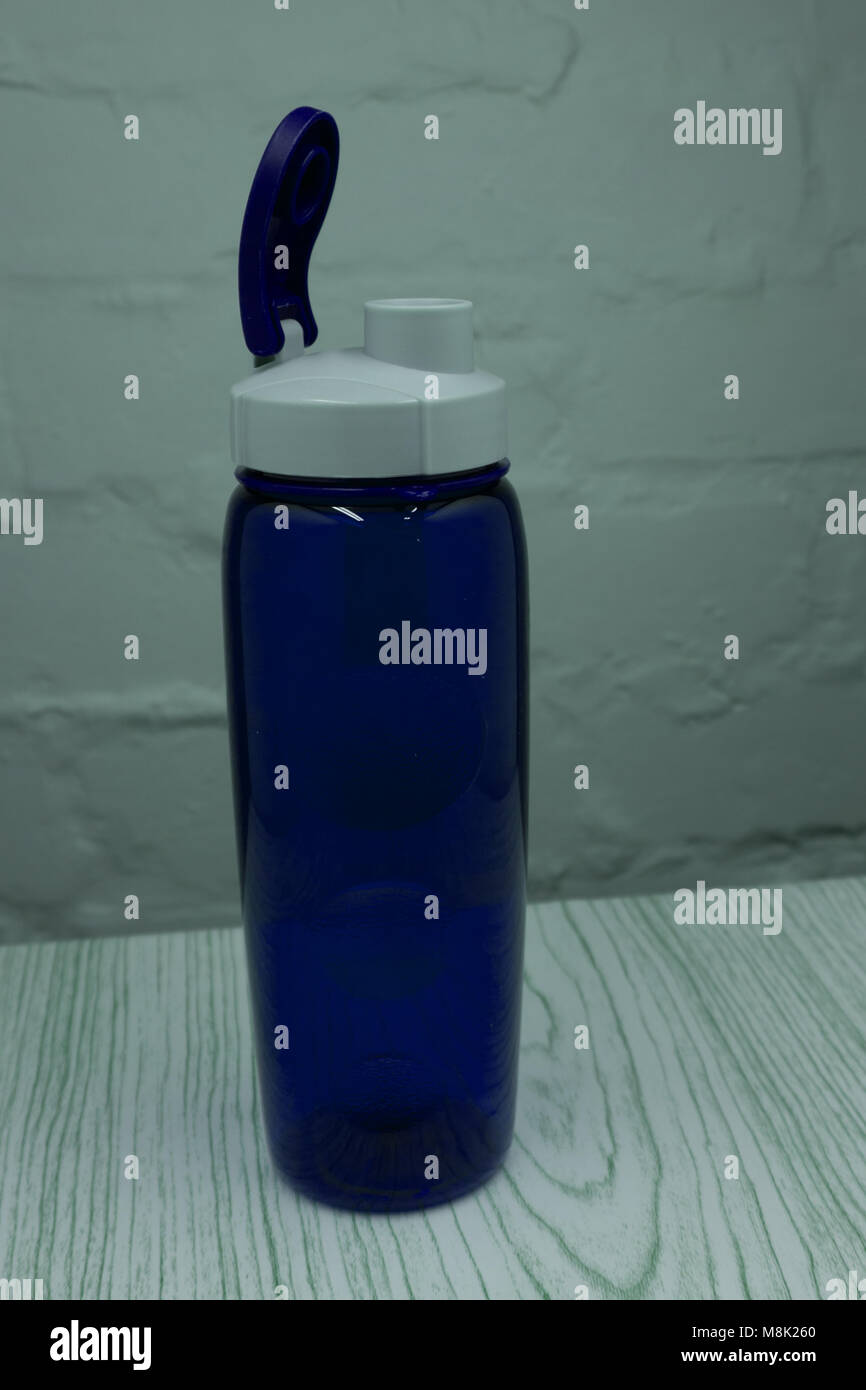 Blue plastic sport water bottle isolated over the white background - Stock Image