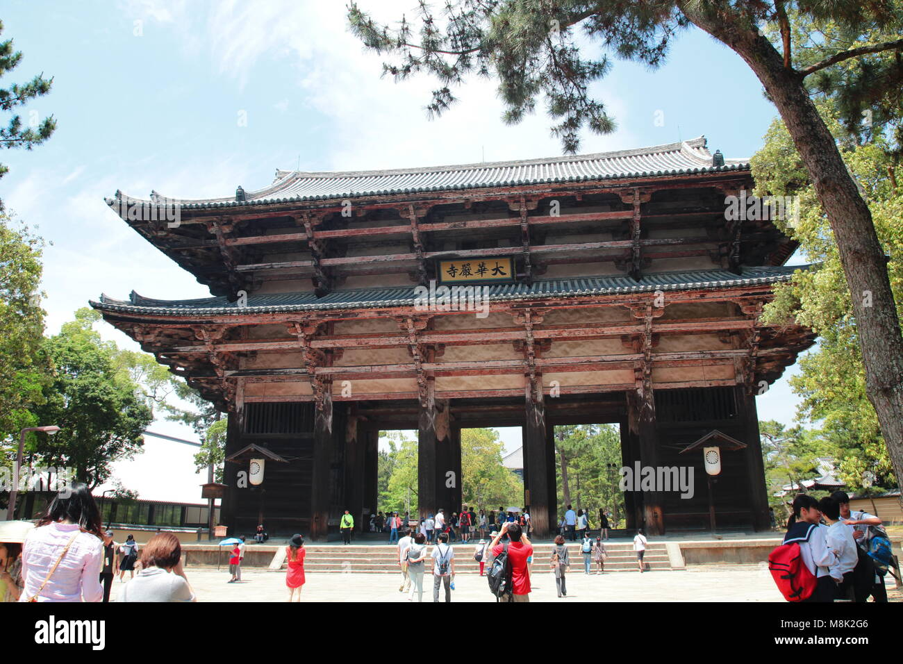 Crowded Chinese tourists visiting Todaiji temple complex in Nara, Japan - Stock Image