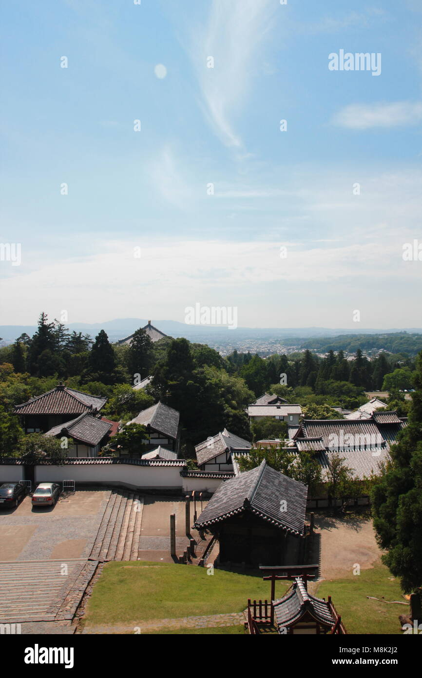 Aerial view of landscape and rooftops from the balcony, deck at Nigatsudo Hall above the part of Todaiji temple - Stock Image