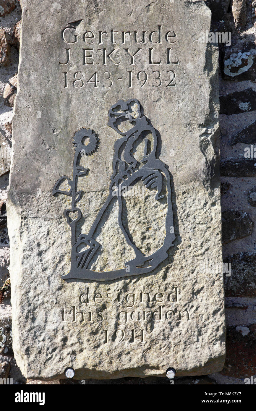 A plaque to the memory of Gertrude Jekyll in the walled garden she designed on Lindisfarne, Holy Island - Stock Image