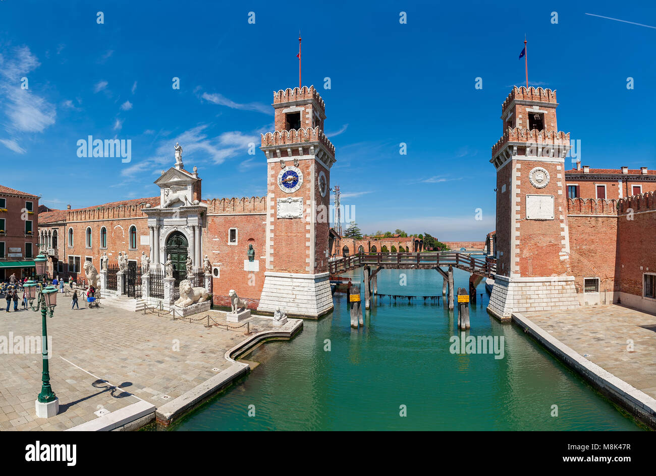 View of small piazza and towers off famous Venetian Arsenal - complex of former shipyards and armories, currently - Stock Image