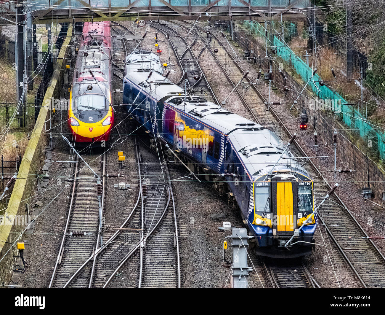Scotrail passenger train and Virgin Trains train and tracks at  Waverley Station in Edinburgh, Scotland, United - Stock Image