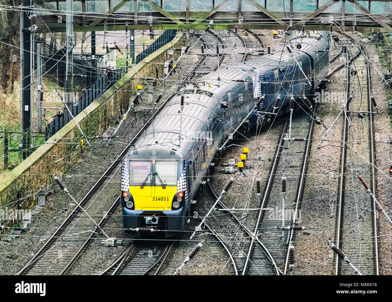 Scotrail passenger train and tracks at  Waverley Station in Edinburgh, Scotland, United Kingdom - Stock Image