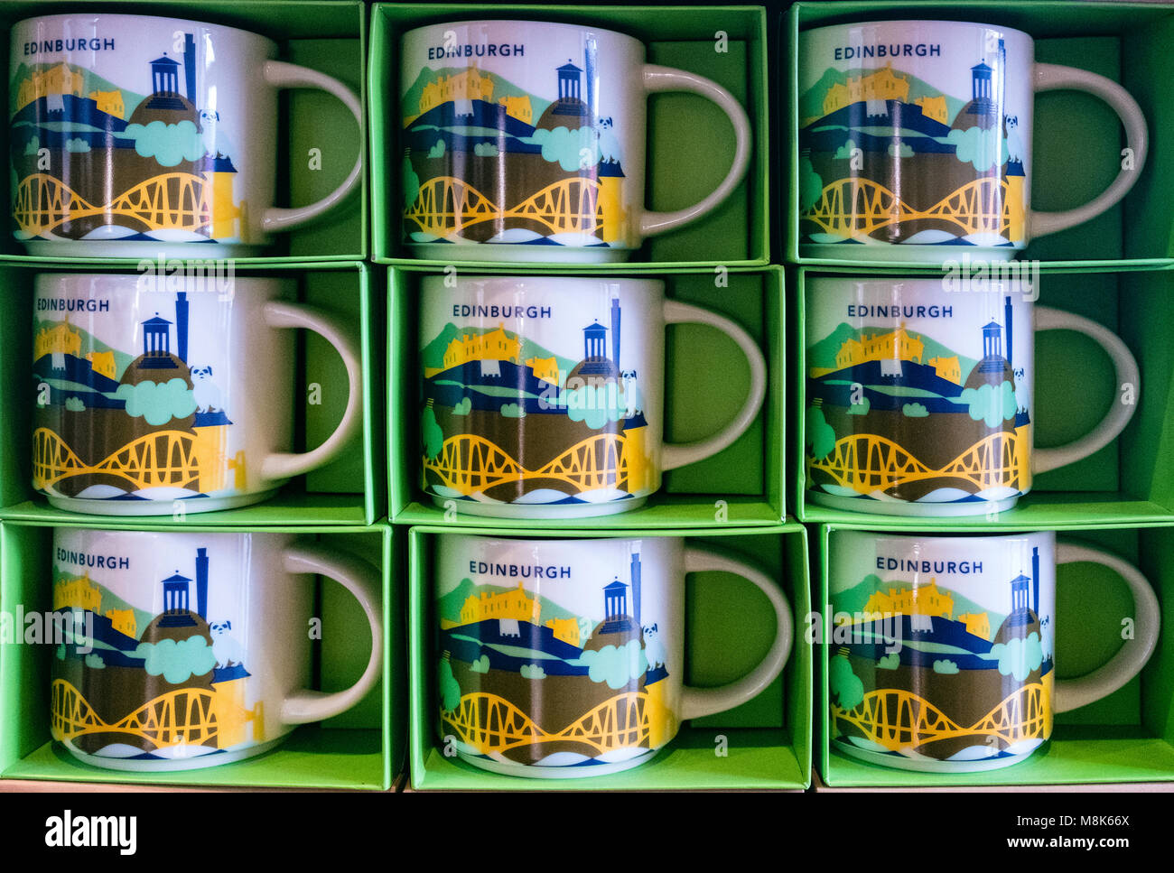 Starbucks mugs for sale in Edinburgh Cafe with themed city logos. - Stock Image