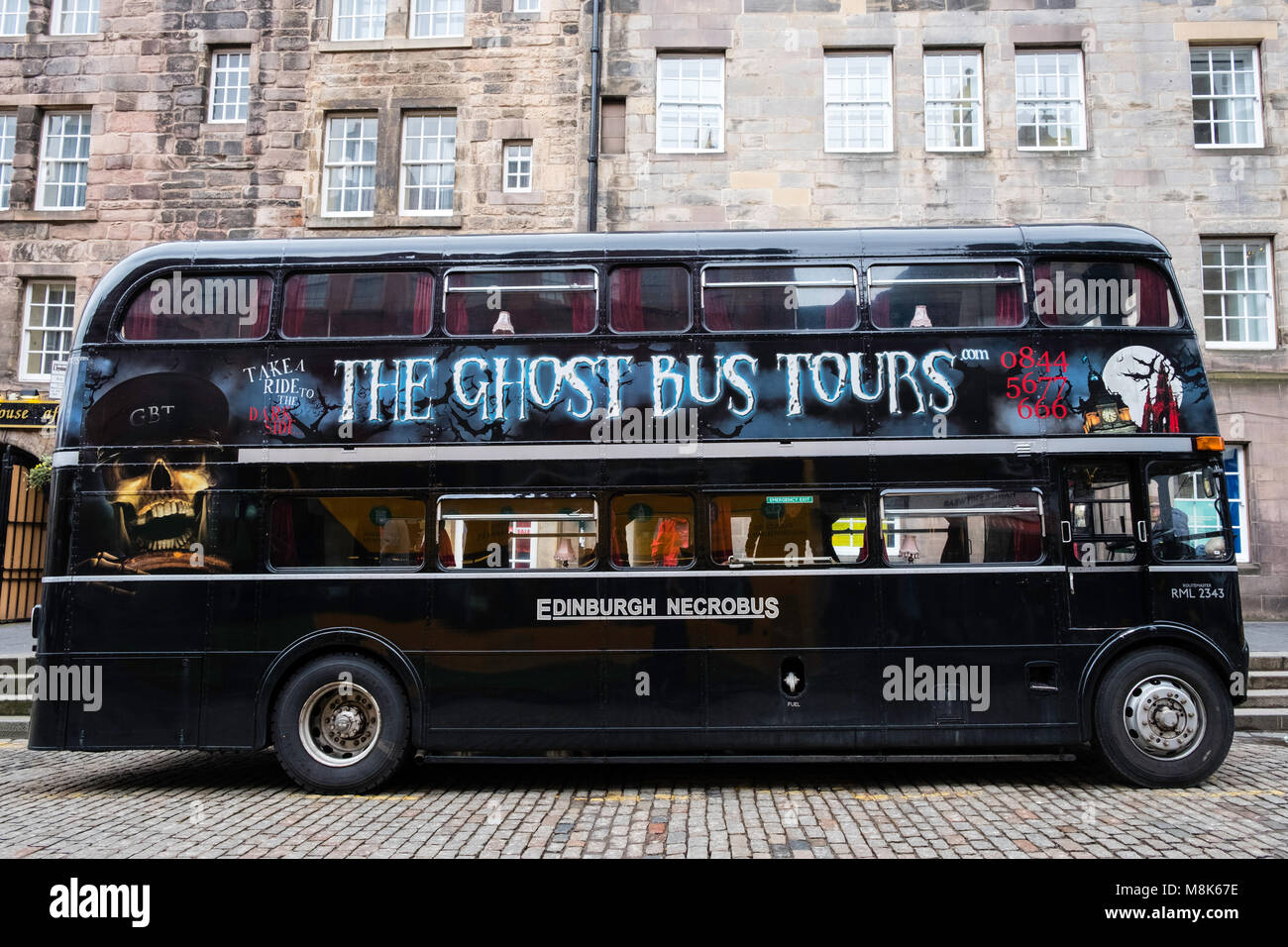 The Ghost Bus Tours double decker bus on the Royal Mile in Edinburgh, Scotland, United Kingdom Stock Photo