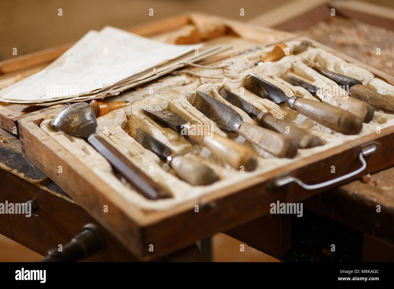 Set of carpenters tools in workshop. Crafting table with instrument - Stock Image