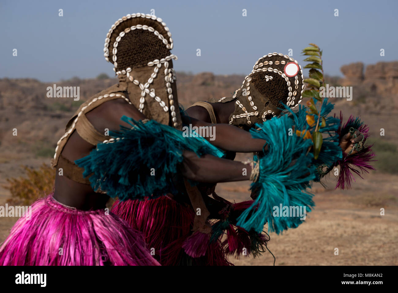 Indigenous Dogon masked dancers engaged in a ritualistic tribal dance. Mali, West Africa. - Stock Image