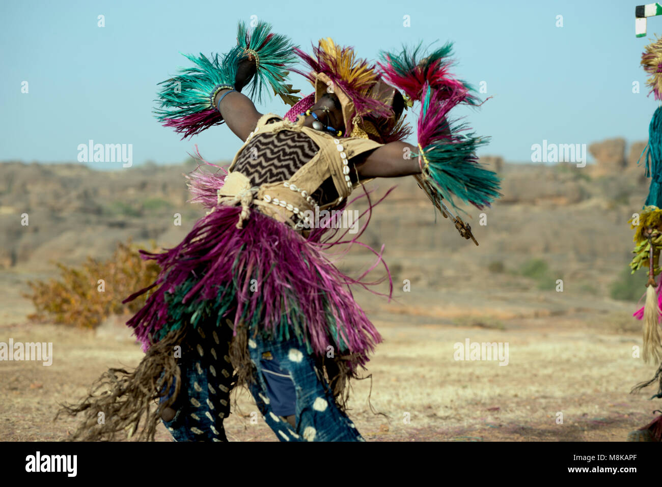 A Dogon masked dancer leaning backwards during a traditional tribal dance. Dogon country, Mali, West Africa. - Stock Image
