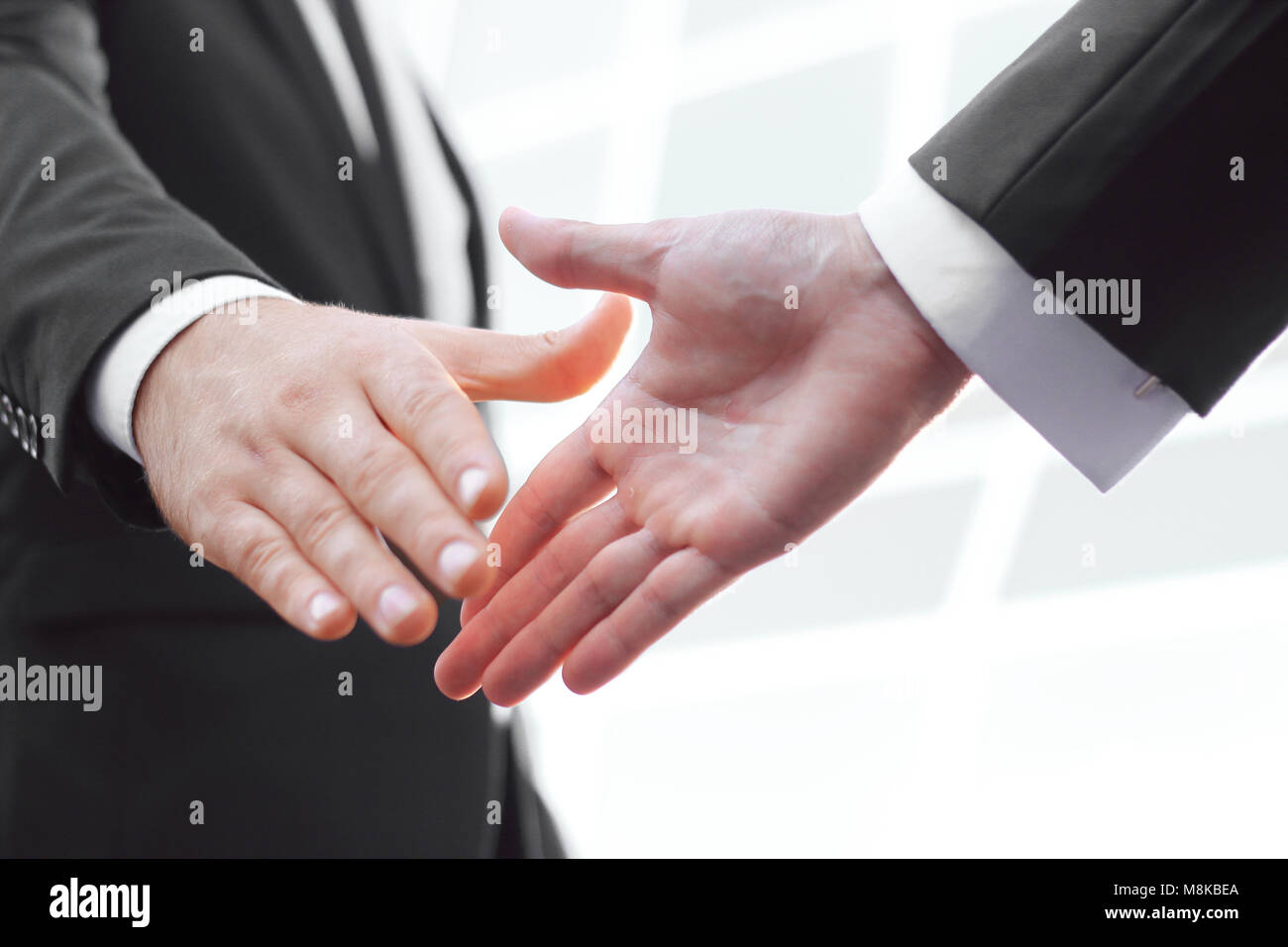 close up. handshake business partners on blurred background - Stock Image