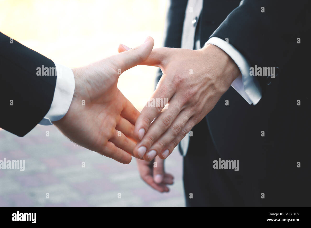close up. handshake business partners on blurred background - Stock Image