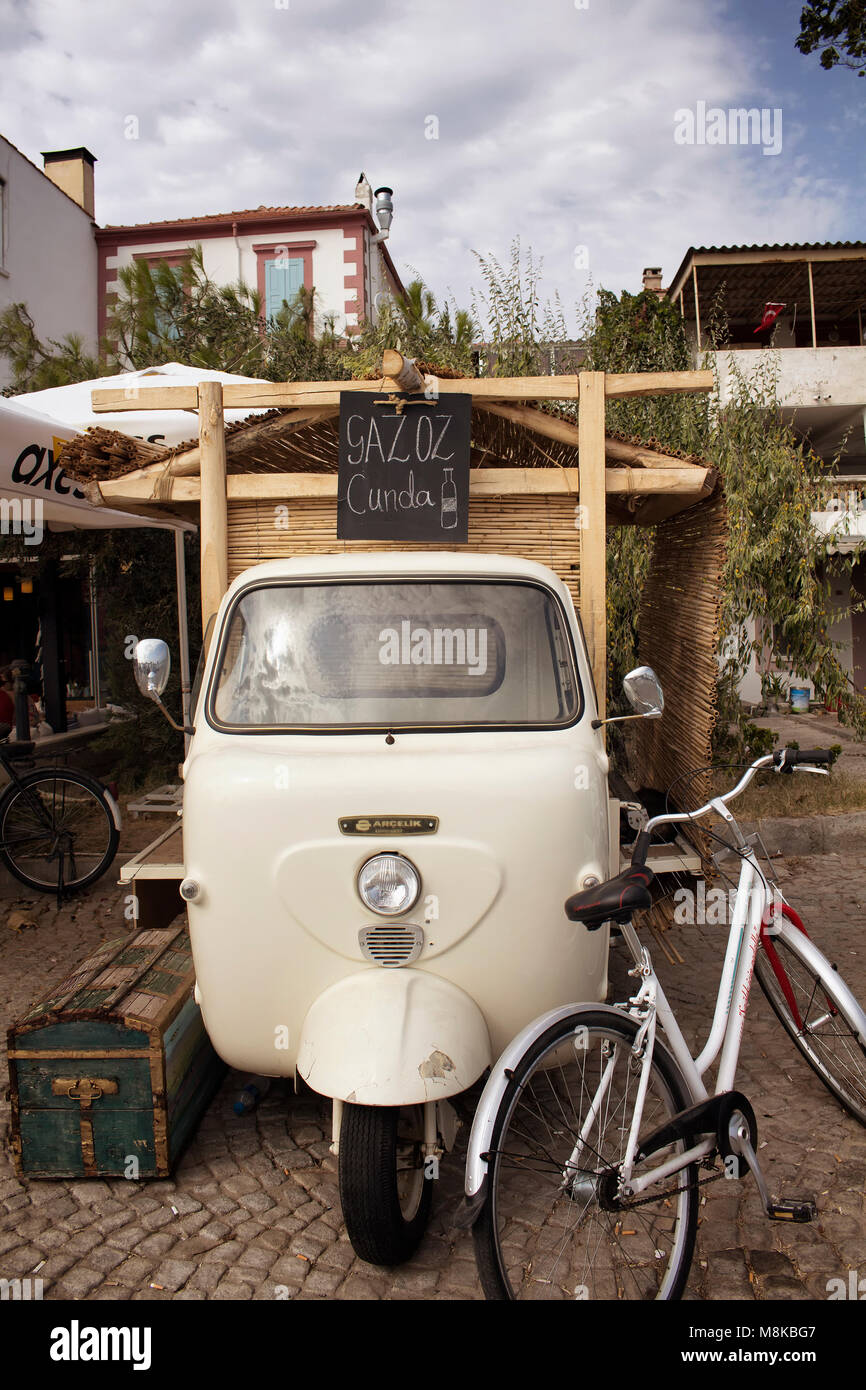 View of retro/vintage small vehicle and bicycle in Cunda (Alibey) island. - Stock Image