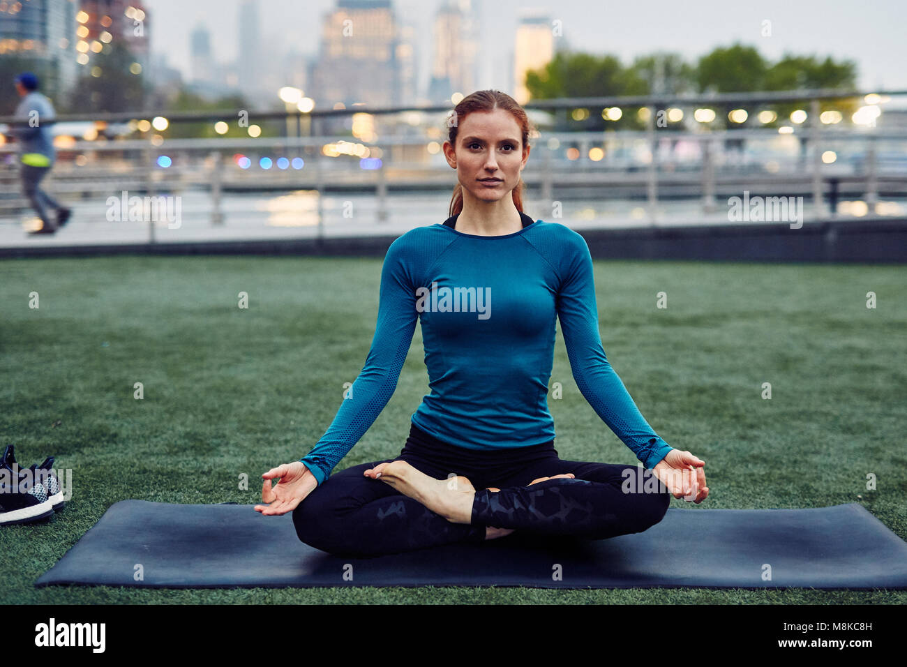 Caucasian Woman Performs Yoga in a Public New York City Park Stock Photo