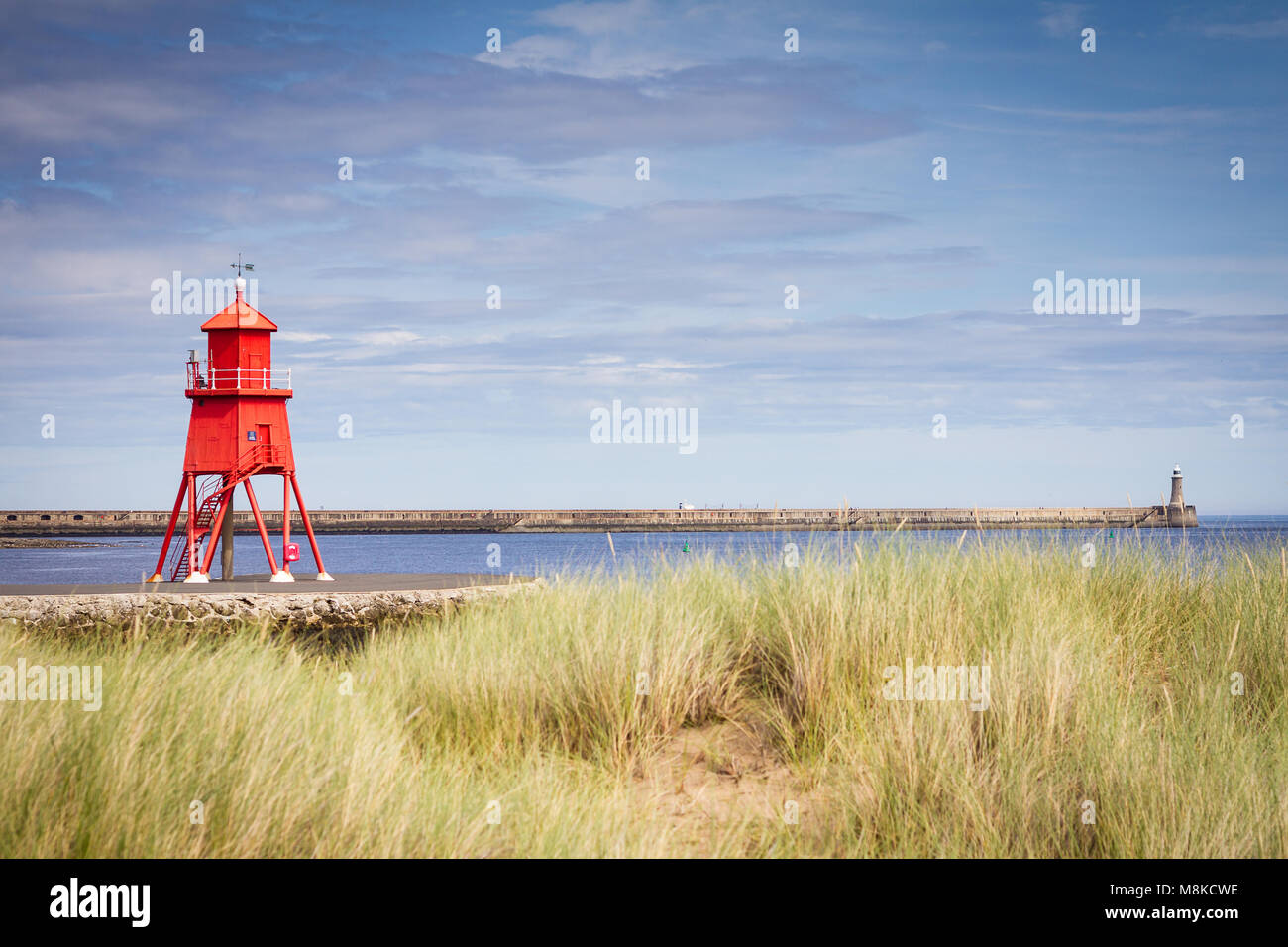 Landscape view of Herd Groyne lighthouse through the Little Haven sand dunes - Stock Image