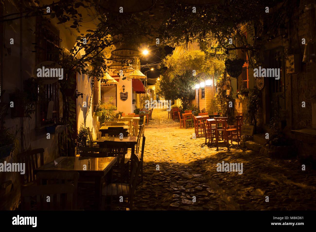 Night view of a street in Cunda island in Turkey - Stock Image