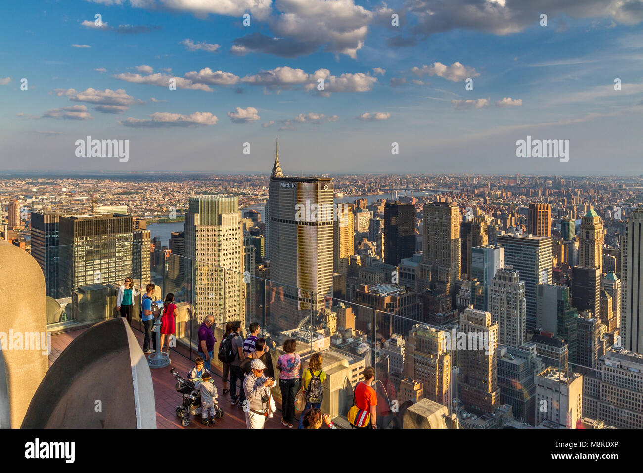 Late afternoon sunshine on Manhattan from The Top Of The Rock Observation Deck on the top Rockefeller Center Building - Stock Image