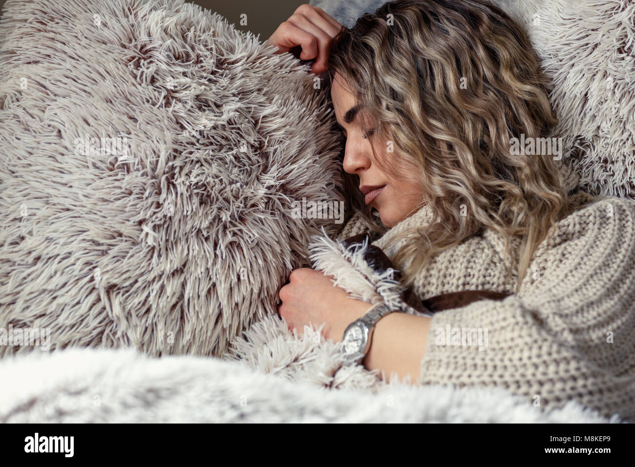beautiful woman is sleeping and dreaming on soft bed at home - Stock Image
