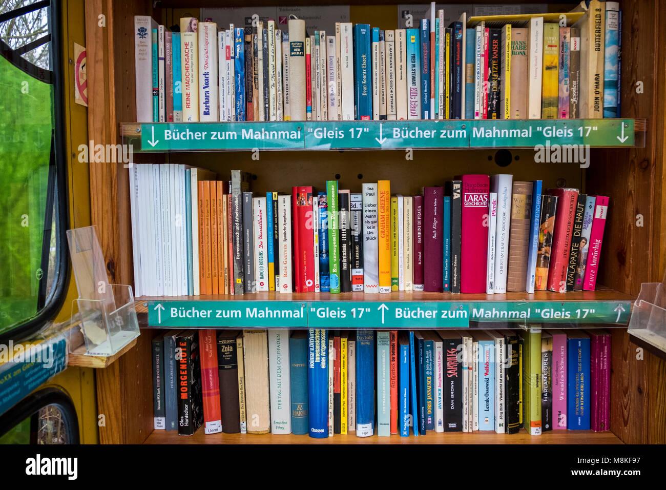 Berlin-Grunewald.Telephone kiosk,BücherboXX,book box. A small 'honesty library' with books.A shelf has books - Stock Image
