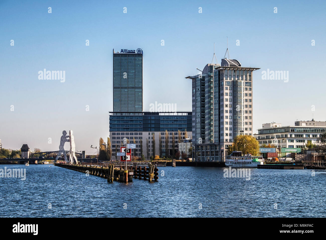 Molecule Man,aluminium sculpture by American artist Jonathan Borofsky in the river Spree-three giant men pierced - Stock Image