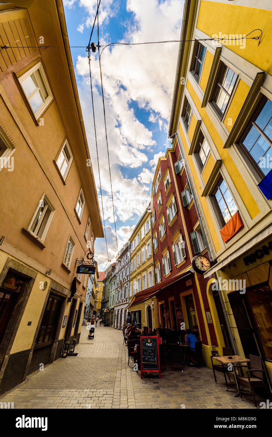 Graz, Styria / Austria - 07 09 2016 : One of colorful alleys in Graz city with historical buildings and restaurants Stock Photo