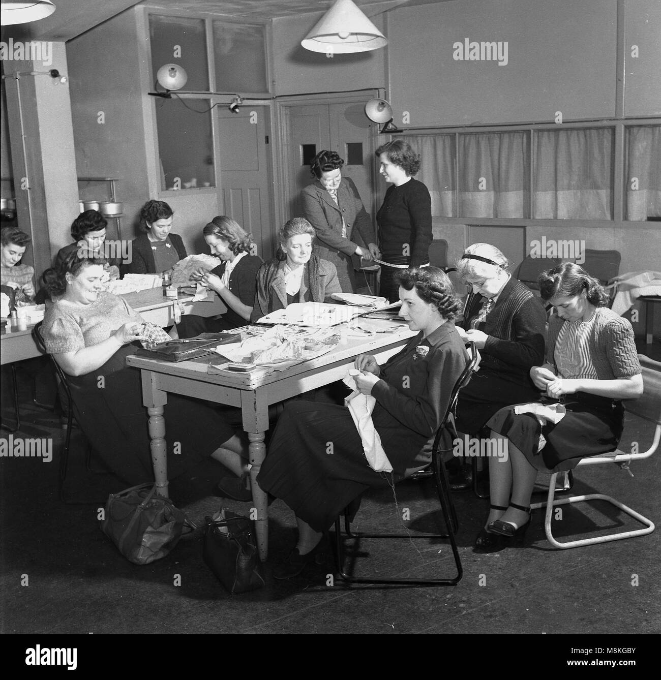 1950s, historical picture of ladies at a sewing or needlework group, England, UK  During and after war, in Britain, - Stock Image