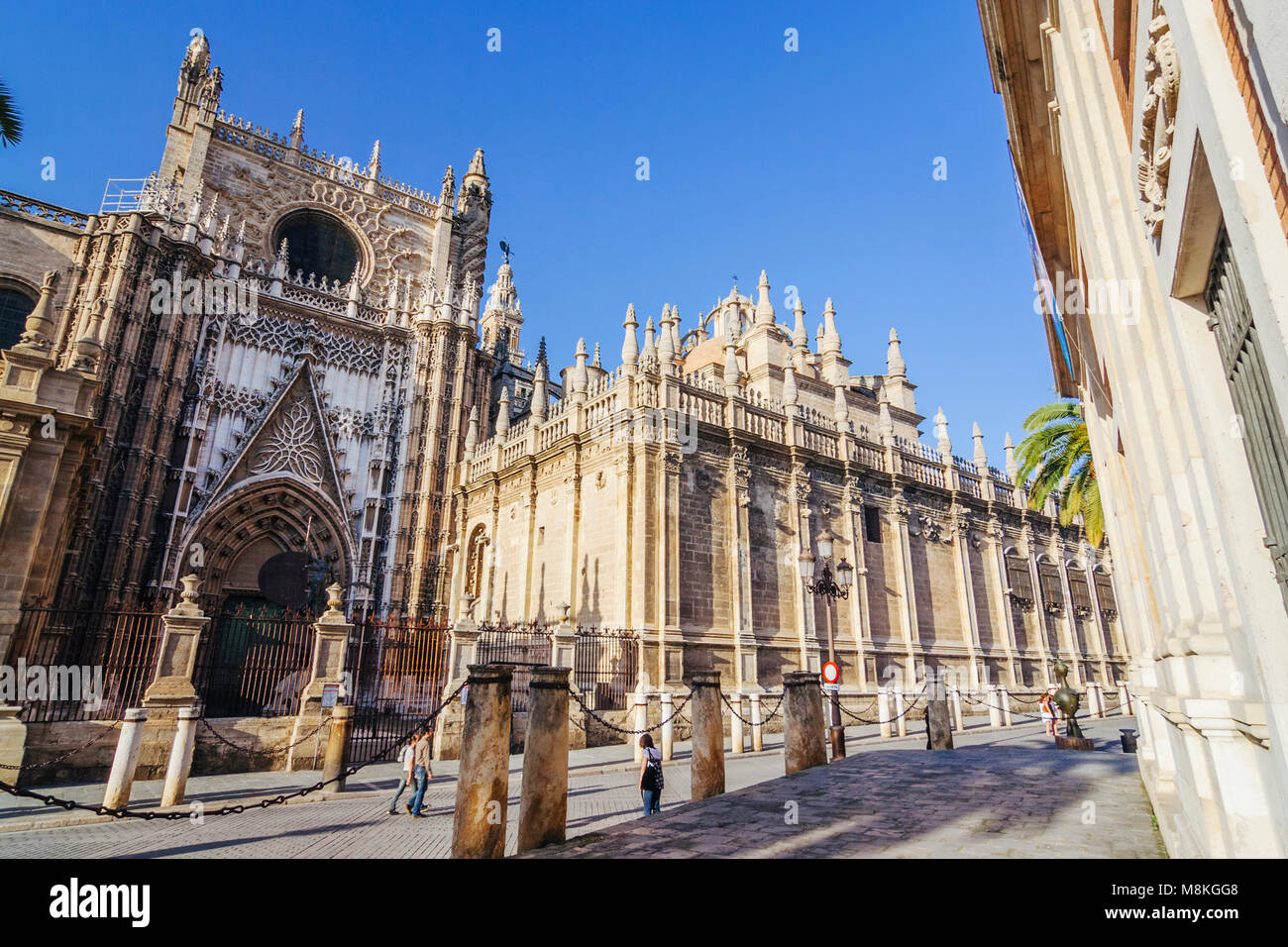 Seville, Andalusia, Spain : Tourists walk past the Puerta del Príncipe (Door of the Prince) of  the Unesco - Stock Image