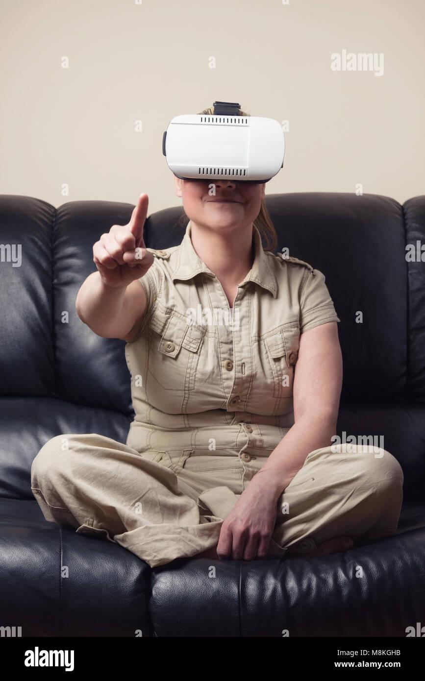 Woman wearing virtual reality glasses - Stock Image