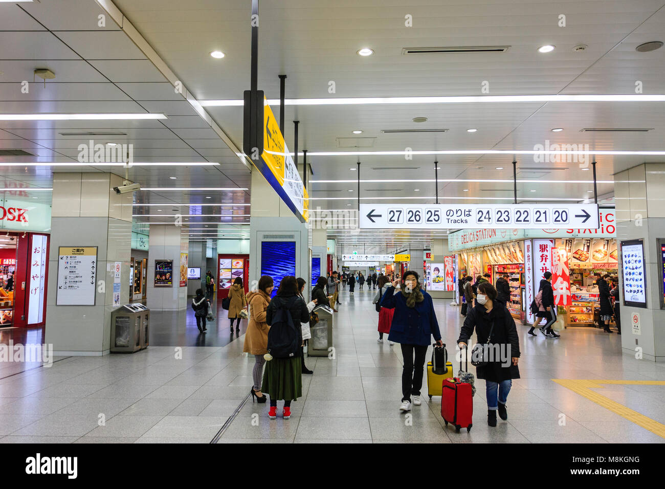 Japan, Shin-Osaka station. Interior of main station concourse in early morning when not very busy. Overhead signs - Stock Image